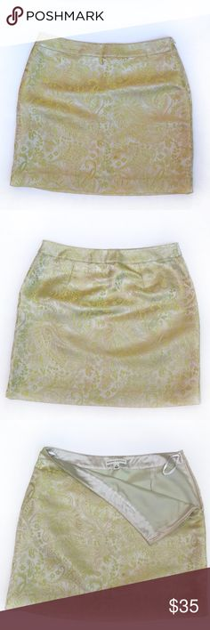 "BANANA REPUBLIC Gold Paisley Mini Skirt, Women's 4 DESCRIPTIONS: BANANA REPUBLIC Gold Paisley Mini Skirt, Women's 4. - Gold Paisley design w/ chartreuse green thread details - Side zipper - Lined  MEASUREMENTS (approx.):  16"" Length; 14 1/2"" Waist. MATERIALS: Shell: 62% Silk/ 25% Rayon/ 13% Metallic/ 100% Acetate Lining; Dry clean. CONDITIONS: Good condition; Shows normal signs of wear; Minor thread pulls. Banana Republic Skirts Mini"