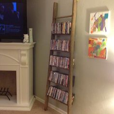 Old wooden ladder DVD shelf! One of the best DIY we have done yet!