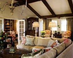 Cottage living room. I like the general setup, but it needs cozier sofas. These look a little stiff.