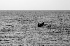 Solitary canoe at sea, Abstract, Abstract photography, canoe, canoe at sea, colomb beach, Fisherman, fisherman at sea, low light, monochrome, Nature, ocean, ripples, sea, Silhouette, Solitary, wave, Photographer Anurag Jain