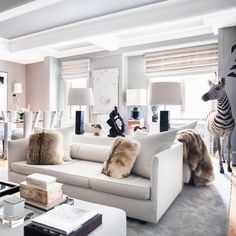 """Known for: Being one of the fashion set's most in-demand (not to mention untrained) interior designers before hitting 30—he counts Alexander Wang and James Franco among his clientele—and reinventing what supremely luxurious and liveable spaces feel like. Wise words:  """"If a client really loves the idea of animal skin, then why don't we put an entire zebra in the apartment?"""" To the left, a Veruschka von Lehndorff-inspired living room designed by Korban."""