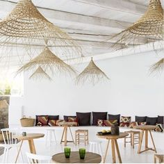 """Sculptural and functional! Love these gorgeous flat weave basket lights at San Giorgio hotel in Mykonos. Love this look? @freedom_australia have some excellent frayed basket lights called the """"Coron"""" series - a perfect substitution for those dreamy beach vibes 