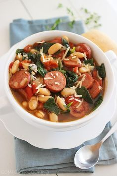 Smoked Sausage, Spinach and White Bean Soup http://www.thecomfortofcooking.com/2014/01/easy-smoked-sausage-spinach-and-white-bean-soup.html