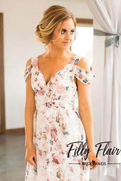 Have your bridesmaids look elegant and whimsical with this beautiful floral bridesmaid dress. This full length gown will give your girls a classic and modest look for any type of wedding. Bust in Smal
