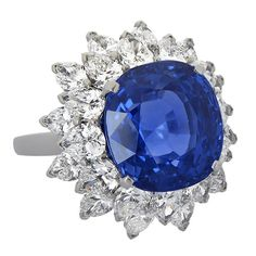An 11ct unheated Ceylon sapphire ring surrounded by a marquise diamond skirt by Bulgari. Circa 1980.