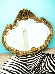 fabulous! vintage wall mirror!    elaborate gold gilt frame.  french style with scroll work and scalopped edges.    huge! measures 51 tall. 60 wide