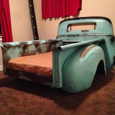 The beginning of Bentley's hotrod room. Patina Aqua paint, and wood grain blanket! Truck bed converted into a twin sized bed for our toddler.