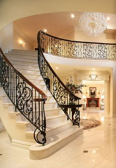 Photo By - Peter Rymwid: beautiful staircase and interior. Wrought Iron Stair Railing, Stair Railing Design, Staircase Railings, Grand Staircase, Grand Foyer, Spiral Staircase, Staircases, Balustrade Balcon, Beautiful Stairs