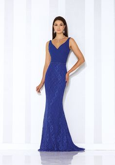 Sleeveless lace and chiffon fit and flare gown with front and back V-necklines, crisscross ruched chiffon bodice with hand-beaded natural waist, lace skirt with sweep train.