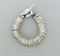 Bracelet | Jill Platner. Sterling silver on leather cord.