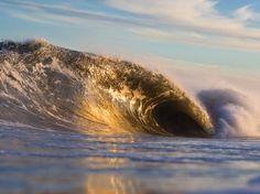 Heavy head-high+ OBX barrels breaking on a knee-high sandbar. 35mph offshore winds