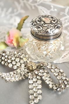 Vintage bling. Place jewellery on a grey surface with other shiny and pretty things like jars.