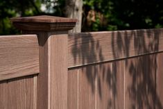 V300-6 Tongue and Groove Vinyl Privacy Fence. Shown in Grand Illusions Vinyl WoodBond Walnut grain (W103). Available in all Grand Illusions Color Spectrum color vinyl fence and Vinyl WoodBond woodgrain vinyl fence matte finishes.