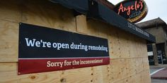 Image result for businesses open during construction signs