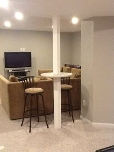 Basement support pole, bar height table. Wood Basement pole wrap preconstucted cut at bar height and circle wood cut in half and fit around pole and glue all in place and paint