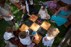 An oversized game of noughts crosses, using large foam tiles for the board.