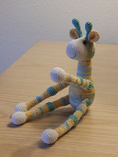Miniature giraffe with adjustable arms and legs by Dawn Holbrook