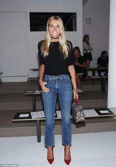 Similar look: Jessica Hart also attended the event in a loose black top that she tucked into her ankle-length denim jeans