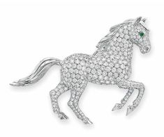 A Diamond and Emerald Horse Brooch, by Cartier