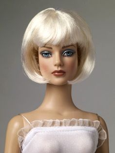 """Manufacturer's catalog image of 16"""" vinyl Nu Mood Sydney Chase doll wearing Blonde Angle Cut doll wig, United States, 2012, by Robert Tonner."""