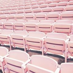 Pink chairs in an auditorium. We would love to see a play, dance, or concert sitting in these cute light pink chairs.