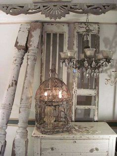 Bird cage lamp and that chandelier---ohh yes!