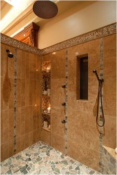 Bathroom Remodeling Must-Haves -- Walk-In Shower with multiple shower heads, built-in niche and corner bench