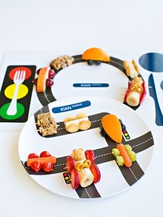 Cutest ideas for car themed food snacks for kids. Make granola, carrot, banana, orange and cheese stick cars. These are fun food ideas for kids car themed parties!