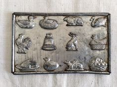 Excited to share the latest addition to my #etsy shop: Antique 1900s Candy Bonbon Chocolate mould / mold metal cast used 12 different mold / mould shapes from animals to baskets to bells.
