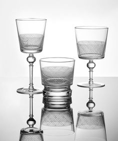 Christofle's Jardin d'Eden crystal barware by Marcel Wanders is positively Augustan in its elegant opulence. From left are the white wine, old-fashioned, and water glasses; $80 each. christofle.com