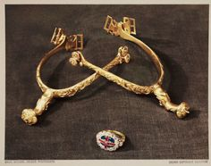 A Vivex colour photograph of a pair of golden spurs and a coronation ring, taken by Dr Douglas A Spencer, in 1937.  This photograph of part of the British Crown Jewels was taken at the Tower of London.
