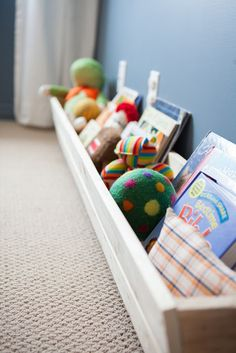 book trough toy storage kids room - could use in the classroom.