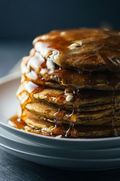 The most fluffy, delicious, filling pumpkin pancakes with healthy whole wheat flour. #pumpkin #pancakes