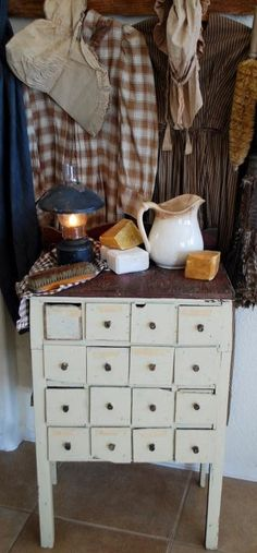 Amazing apothecary table...love the drawers. Such personality!