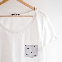 You only need 10 minutes and a few cheap supplies to spruce up a plain tee! No sewing required, step by step tutorial and pattern included.