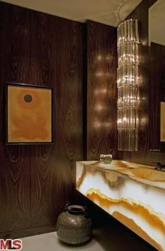 powder room / bathroom, with backlit onyx, and crystal light fittings.