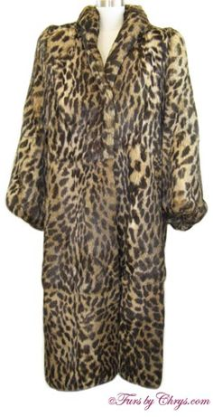 Plus Size Spotted Rabbit Coat #SR782; $950.00; Excellent Condition; Size range: 18 - 22. This is an amazing genuine dyed spotted rabbit fur coat in a nice, long length and in a very generous size. It has a Polo Norte Furs label and features a small wing-style collar, blousy sleeves with lightly elasticized sleeve ends, and large shoulder pads. This is a very high quality rabbit coat with super plush and very silky soft fur. Unlike many rabbit coats, it has minimal shedding. fursbychrys.com