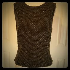 Fully beaded silk tank SZ 10 gorgeous This dressy tank is absolutely gorgeous. Fully beaded from top to bottom dark brown beads with gold accents when it sparkles. Zippers all the way down the back. Size 10 in perfect condition. This would be beautiful under a sweater or alone. Gorgeous for the holidays. By Kay Unger evening wear. Heavy and weight due to all the beating. No beads missing at all. Kay Unger Tops Tank Tops