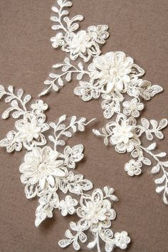 lace applique A lot of 2 vintage beaded lace applique - made in france. $20.00, via Etsy.    add this on a ribbon sash with some beads and pearls and handmade fabric flowers and you have yourself a beautiful bridal belt