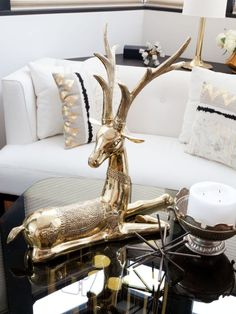 Eye candy for the Home  I am currently obsessed with brass figures and have been eyeing a few cute ones at CuriosityCabinet.  Then, I came across this stunning Eye candy for the Home brass figure in the picture below and thought it ties in very nice with the pillow cushions and the other small decor items. #homedecor #decor #accent #decoration #gold #eyecandy