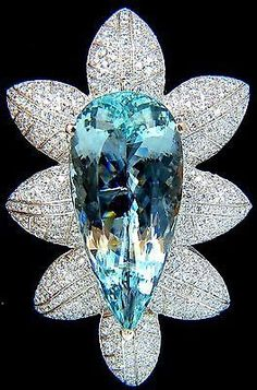 69.37ct. Natural GIA Certified Aquamarine & 8.00ct. diamonds brooch. 3D Still Life Snowflake , Brilliant pear cut. 43.45 X 20.30 X 13.70mm 8.00ct. Natural Diamonds: Round Full cuts.  Mounted, bead set & Master Craft Graver patterns 18Kt. White Gold.