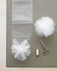 DIY- How to make netting or tulle Pom poms~ great idea to embellish packages, use with a string of lights to decorate for a wedding or the winter holidays, etc. @ DIY Home Crafts