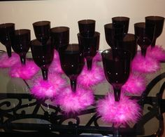 Used plastic goblets and cut to length a boa around bottom of goblet and glued it
