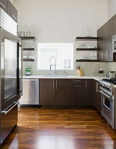 Kitchen of the Day is out!  Chocolate, modern & stainless steel.  The 3 words that add value!