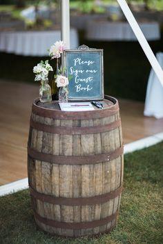 Oak wine barrel as guest book table