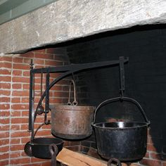 Central Chimney Fireplace with Hand Forged Crane and Trammels