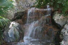 Create a backyard waterfall without a kit.