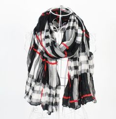 http://www.artfire.com/ext/shop/studio/bohemiantouch/1/1/10311//  Black White and Red Stripe Shawl Scarf, scarf is a great addition to your collection of fashion accessories. Perfect for all year round.