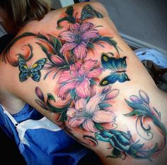 Check out Lily tattoo idea on back. We add new tattoo designs on a daily basis. Some of the coolest tattoos you will ever see. Floral Back Tattoos, Butterfly With Flowers Tattoo, Flower Tattoo Back, Flower Tattoos, Rose Tattoos, Butterflies, Lotus Flower, 3d Tattoos, Cover Up Tattoos