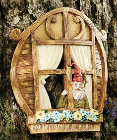 Normally this wouldn't be my style, but part of the backyard is Hailee's Secret garden.  I think she would LOVE this!  Gnome Window Tree Art